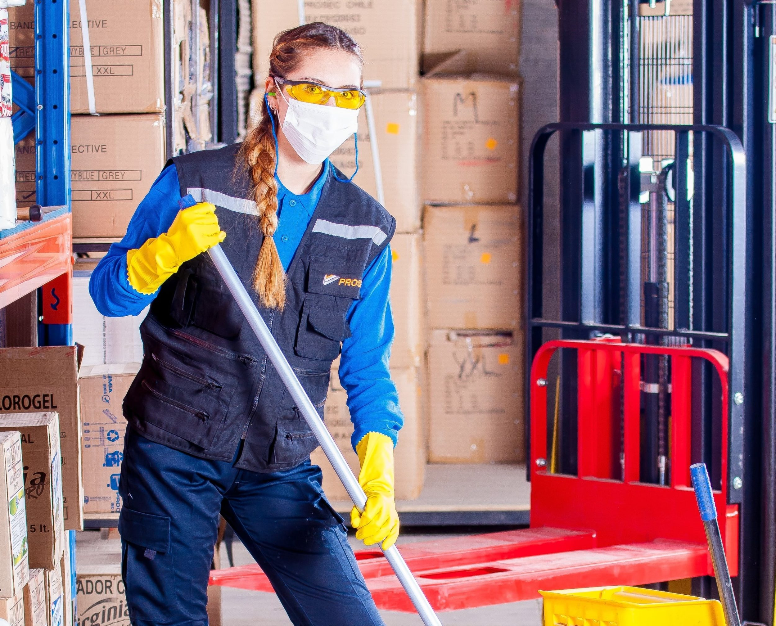 Woman in face mask holding mop